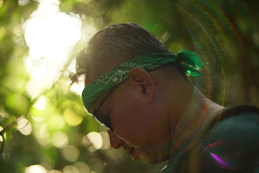 man wearing green and white bandana
