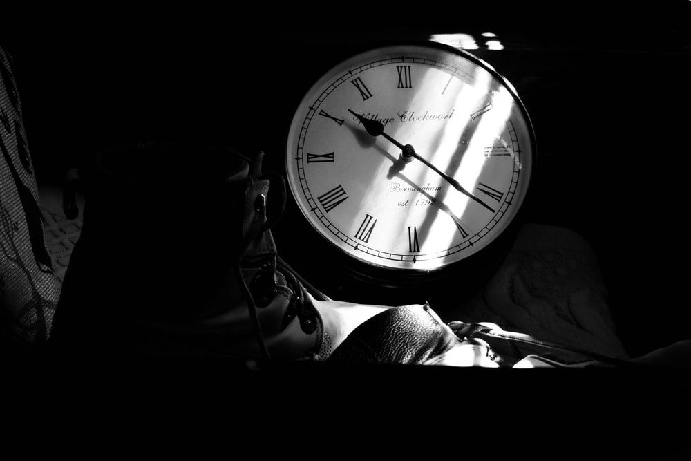 grayscale photography of analog clock
