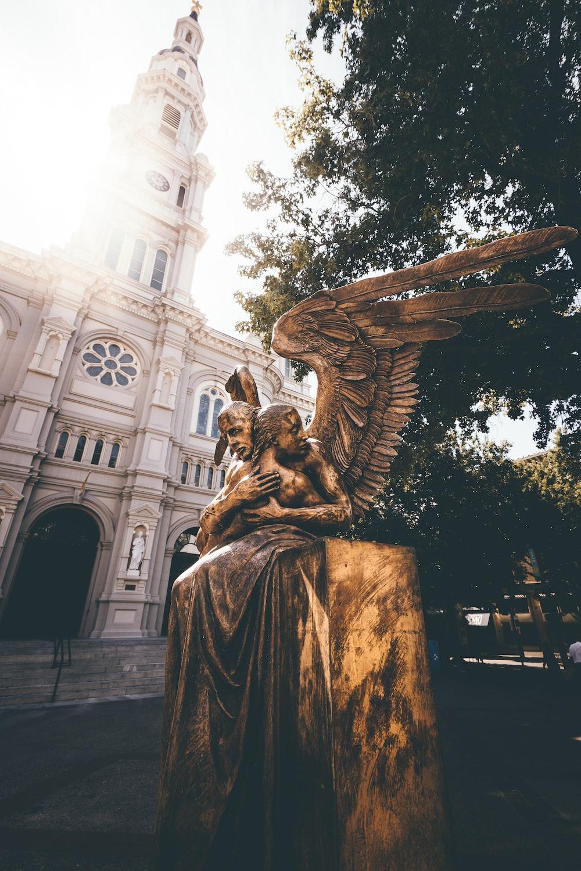 angel hugging woman statue