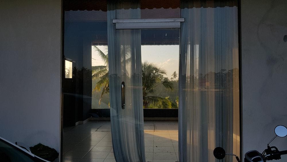 closed glass door in empty room