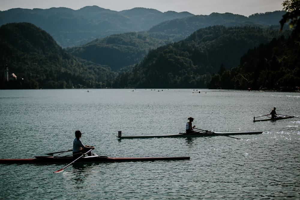 three people riding boat