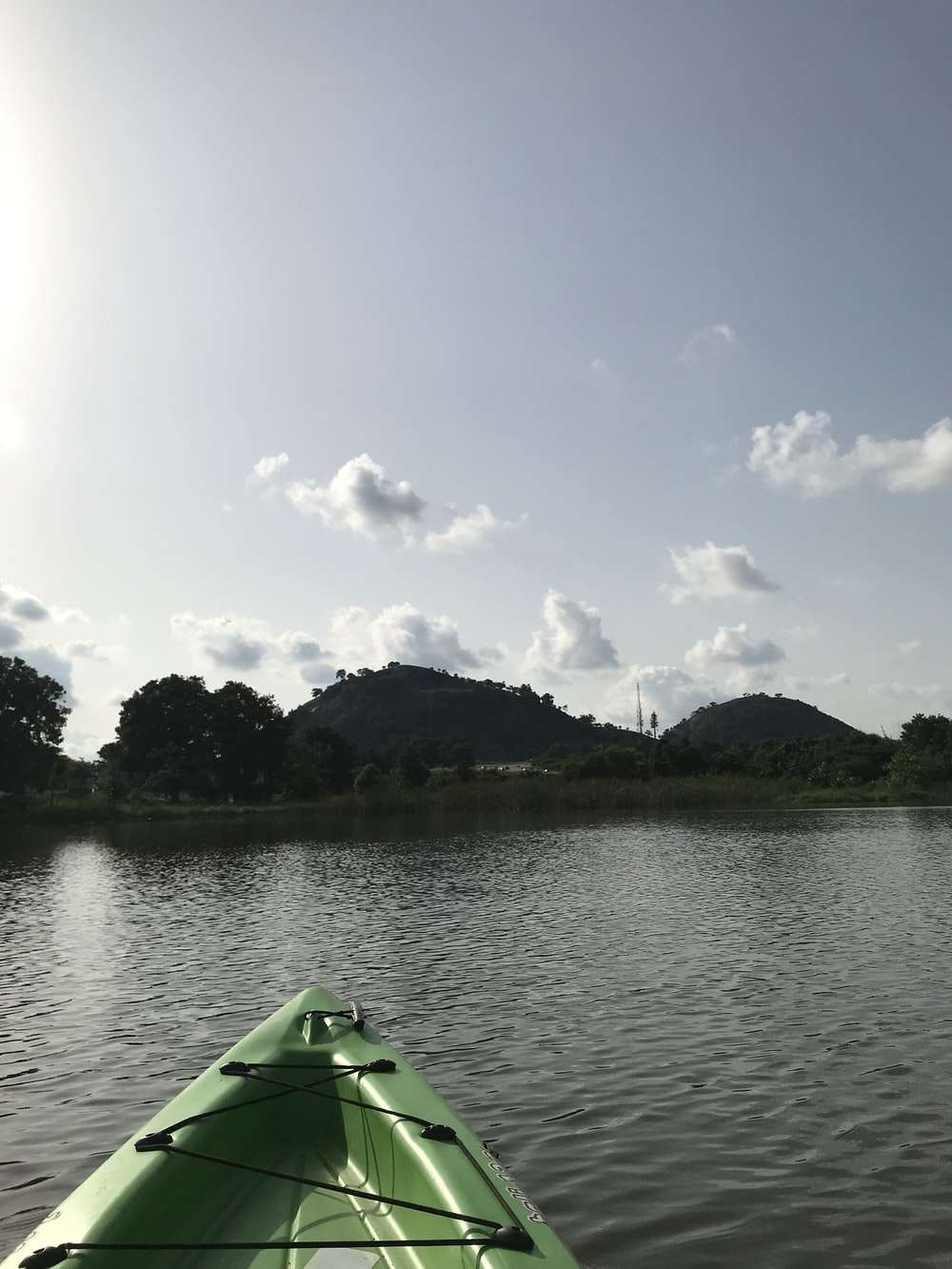 green canoe in lake
