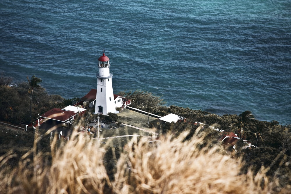 white and red painted lighthouse scenery