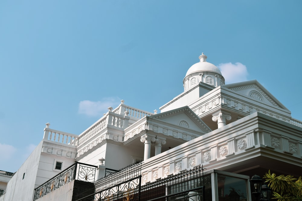 architectural photo of a white mansion