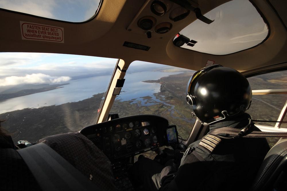 pilot near body of water during daytime