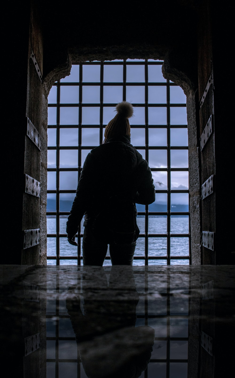 silhouette of person standing near gate