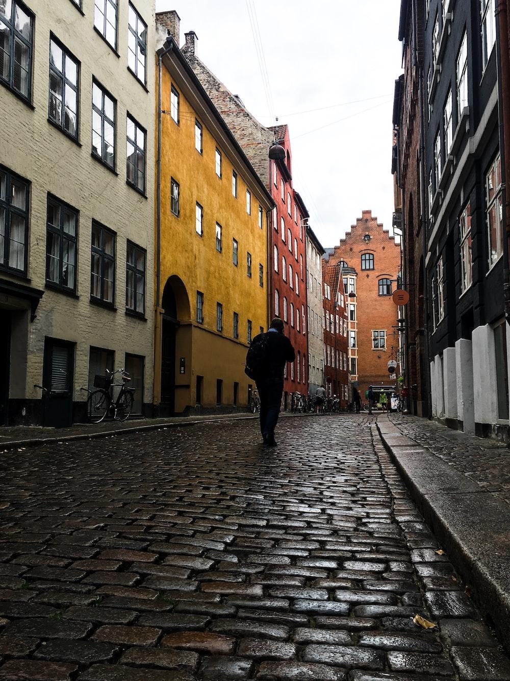 man walking in alley