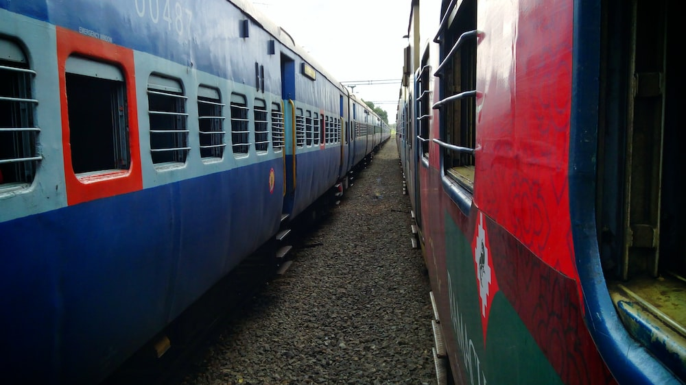 blue, white, and red train