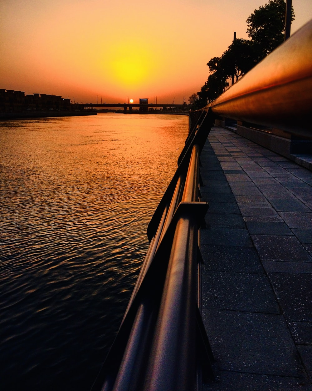 urban photo of a river at sunset