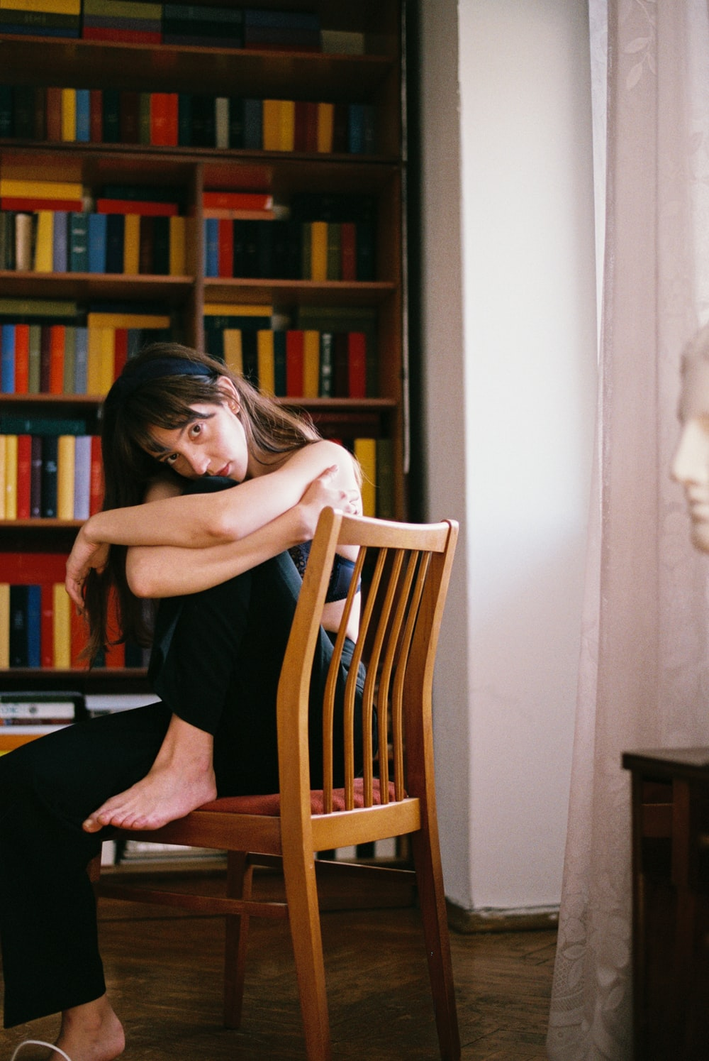 woman sitting on brown chair
