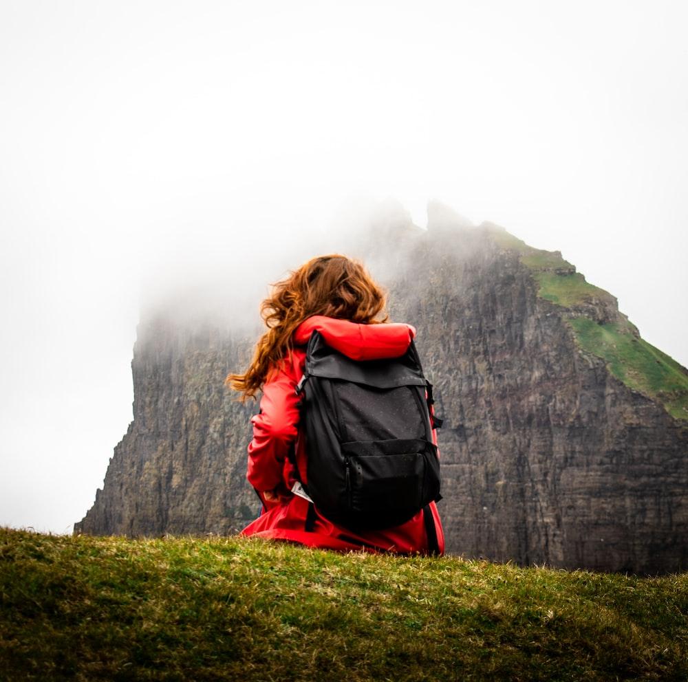 woman near rock formation