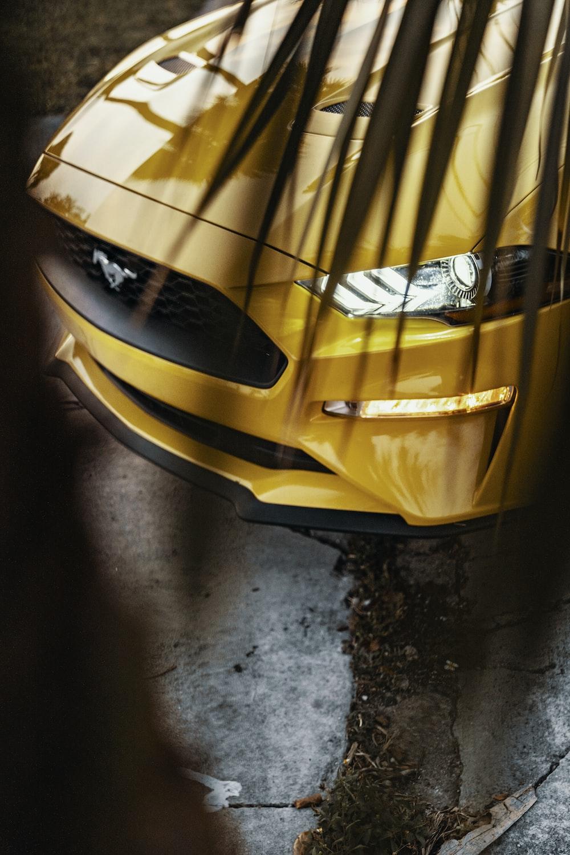 yellow and black Ferrari car