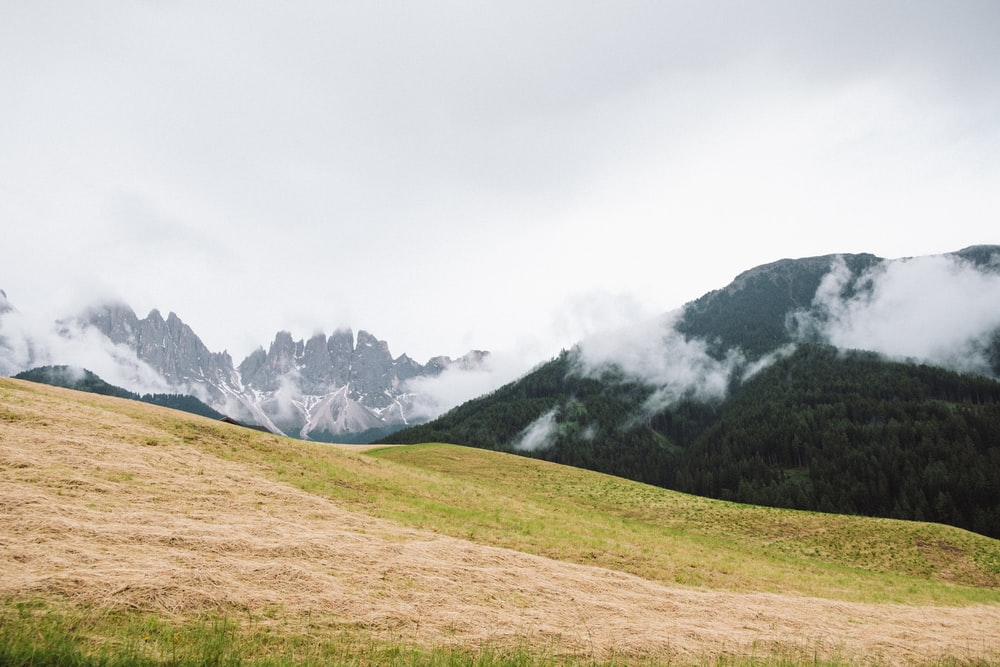 green grass field near mountain