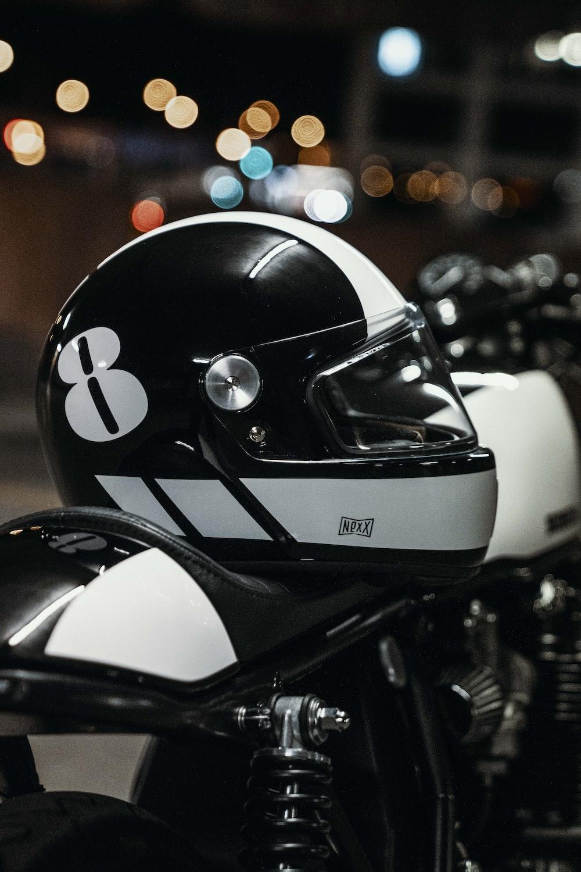 white and black helmet on motorcycle