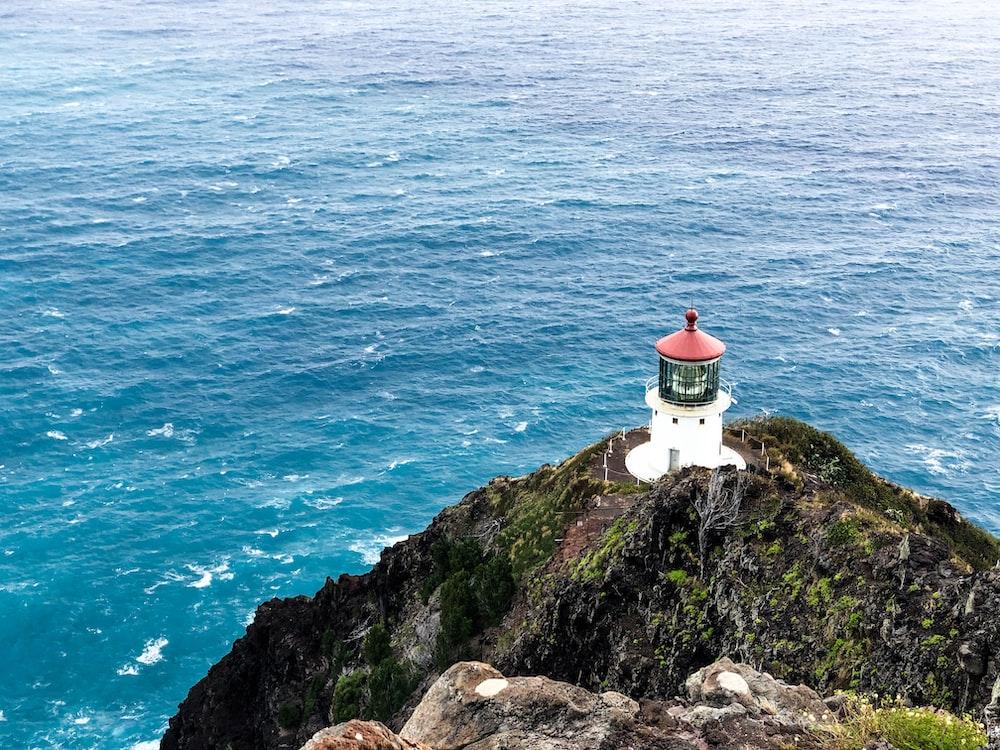 white lighthouse near ocean