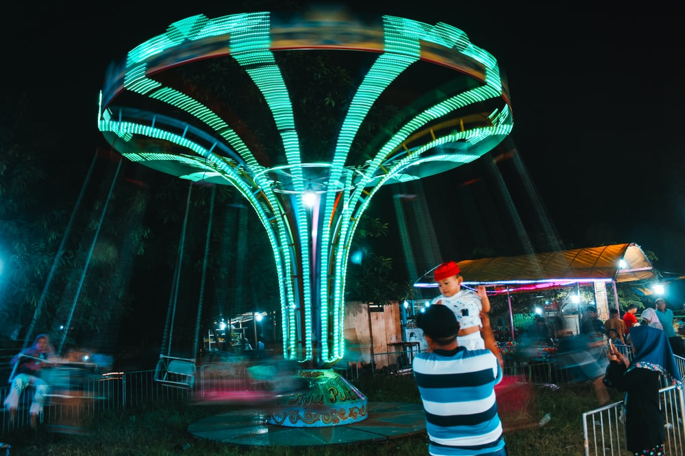 people near theme park ride at night