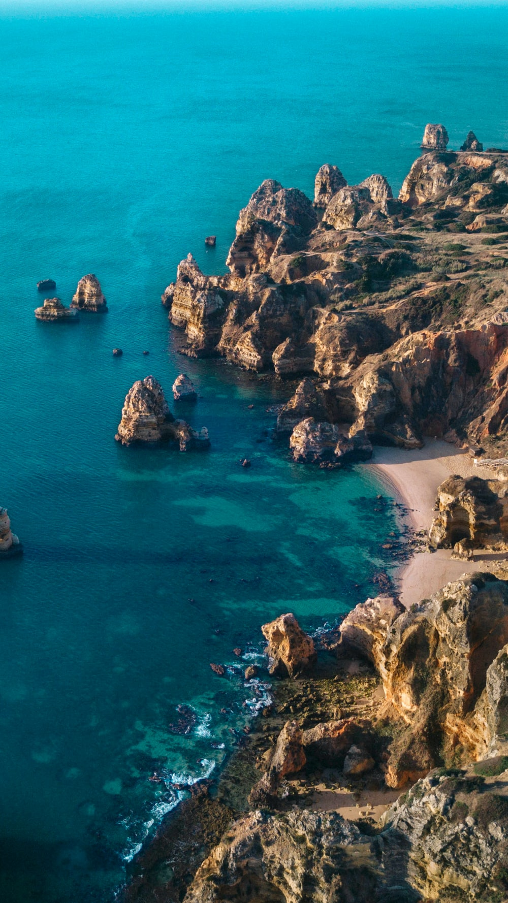 brown rocky cliff in beach