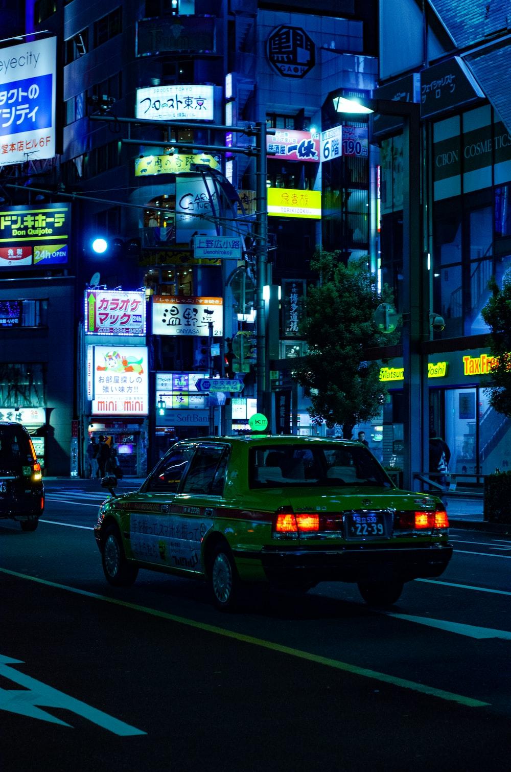 yellow sedan during nighttime