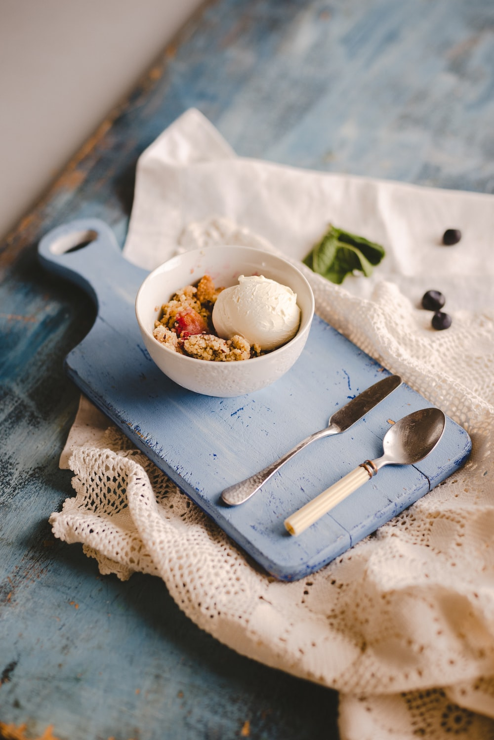 cooked egg and round white ceramic bowl