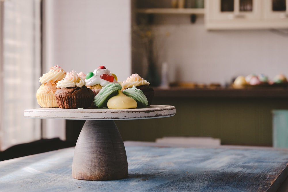 cupcake on round wooden board