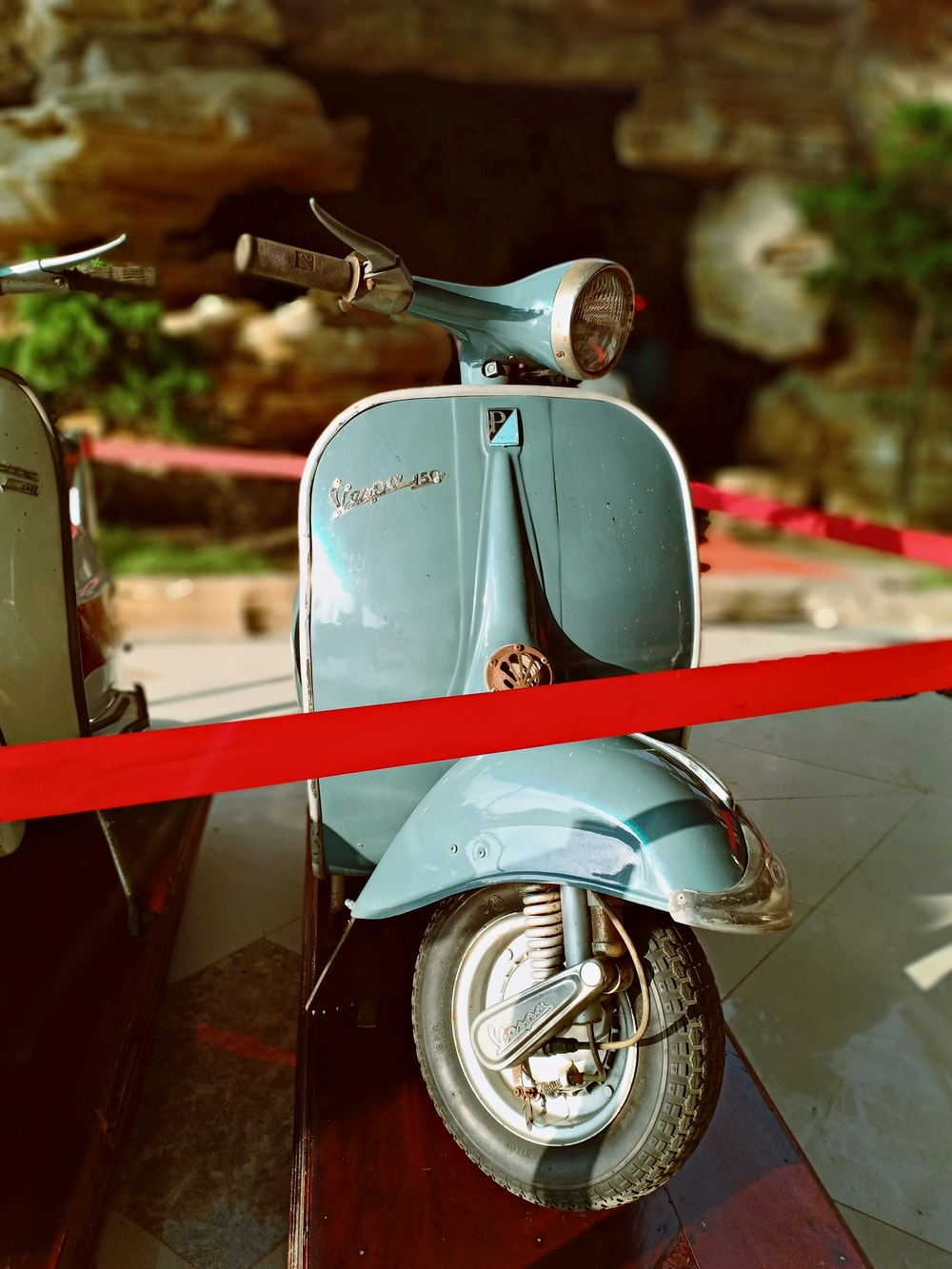 blue motor scooter