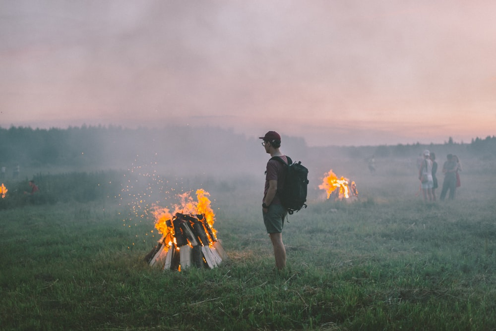man standing near flame