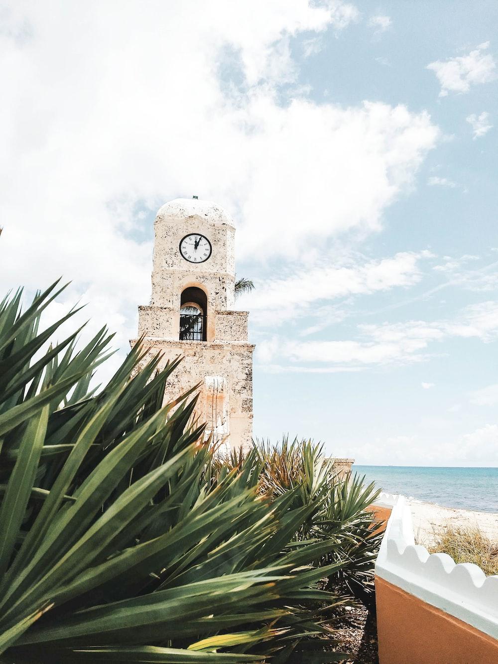 beige stone wall clock tower