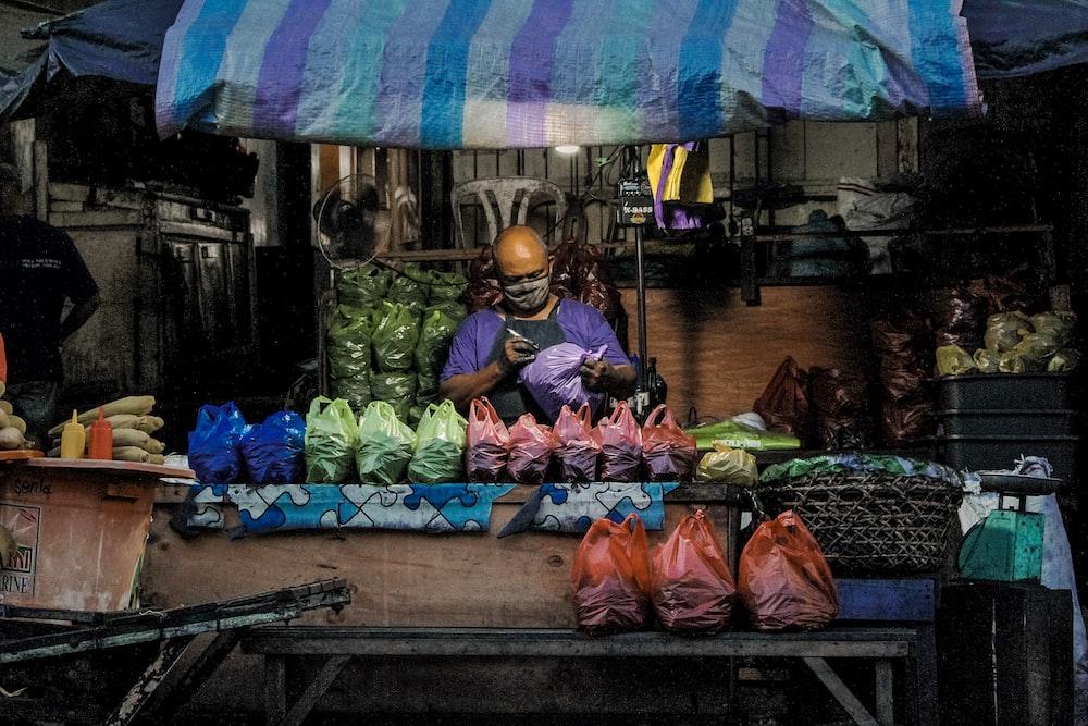 man in purple top