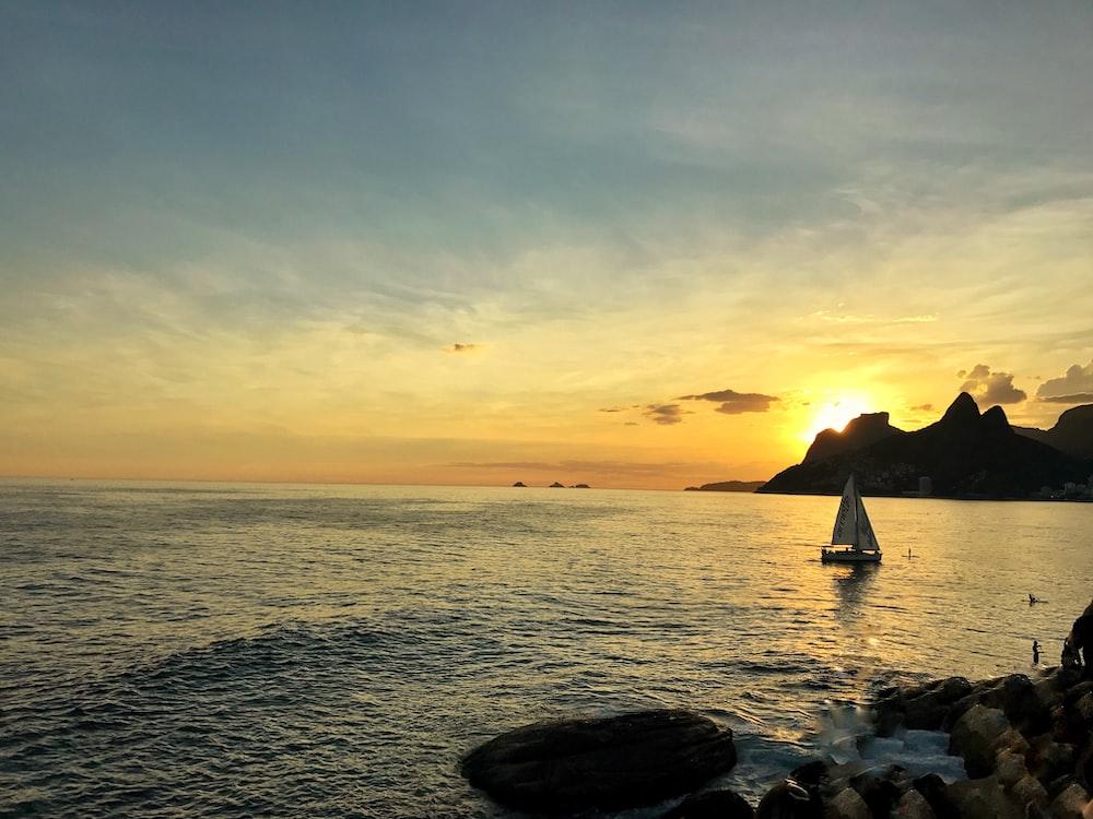 white sailboat near island