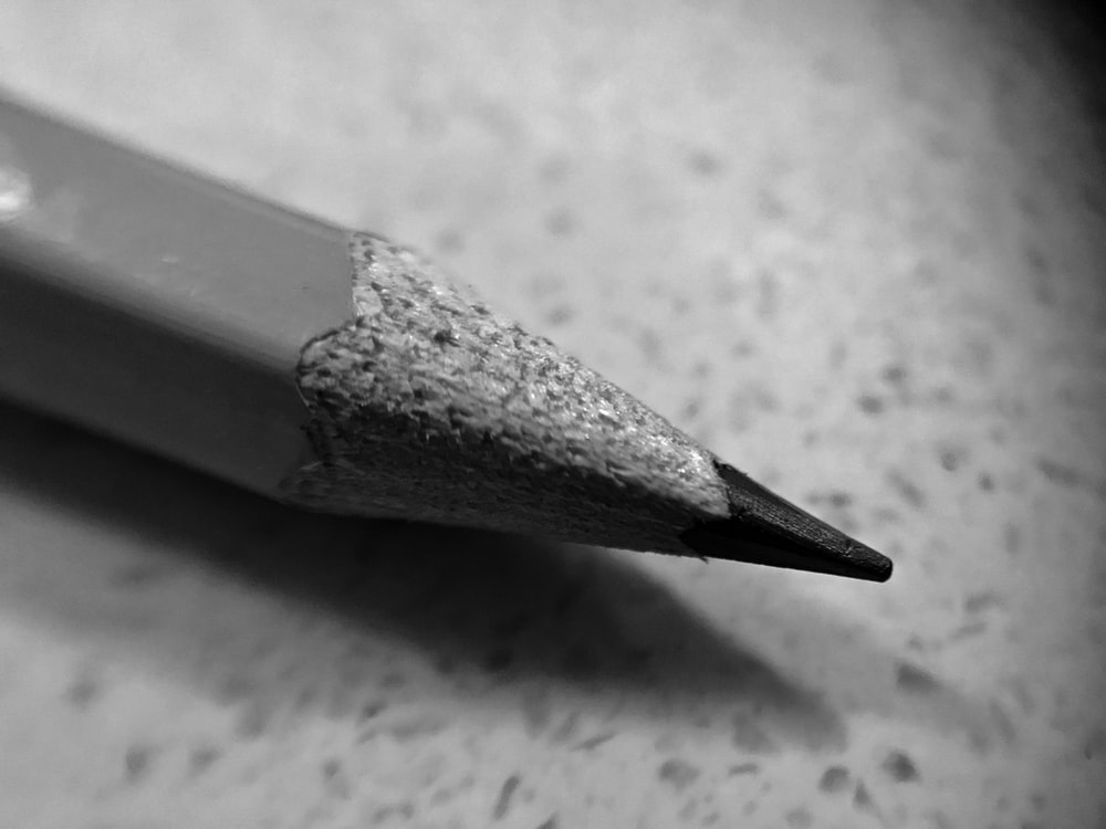 grayscale photo of pencil