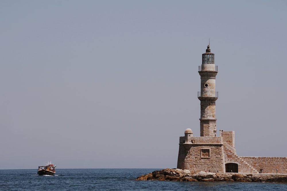white and gray lighthouse at daytime