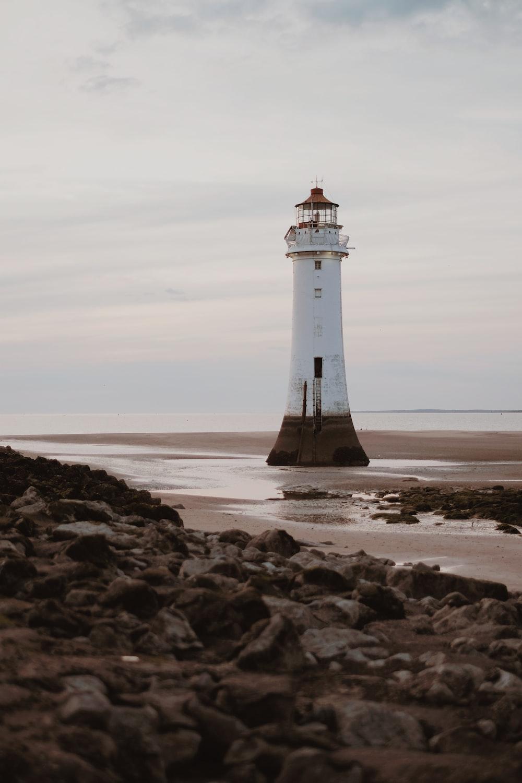 white lighthouse on seashore
