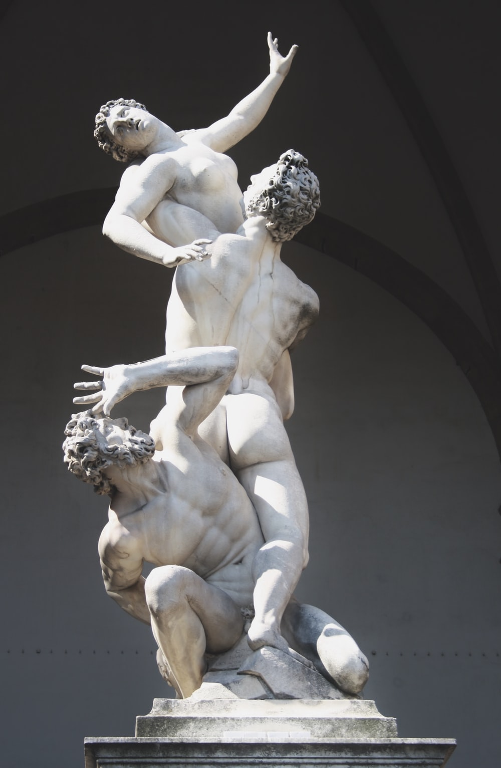 woman and men statue