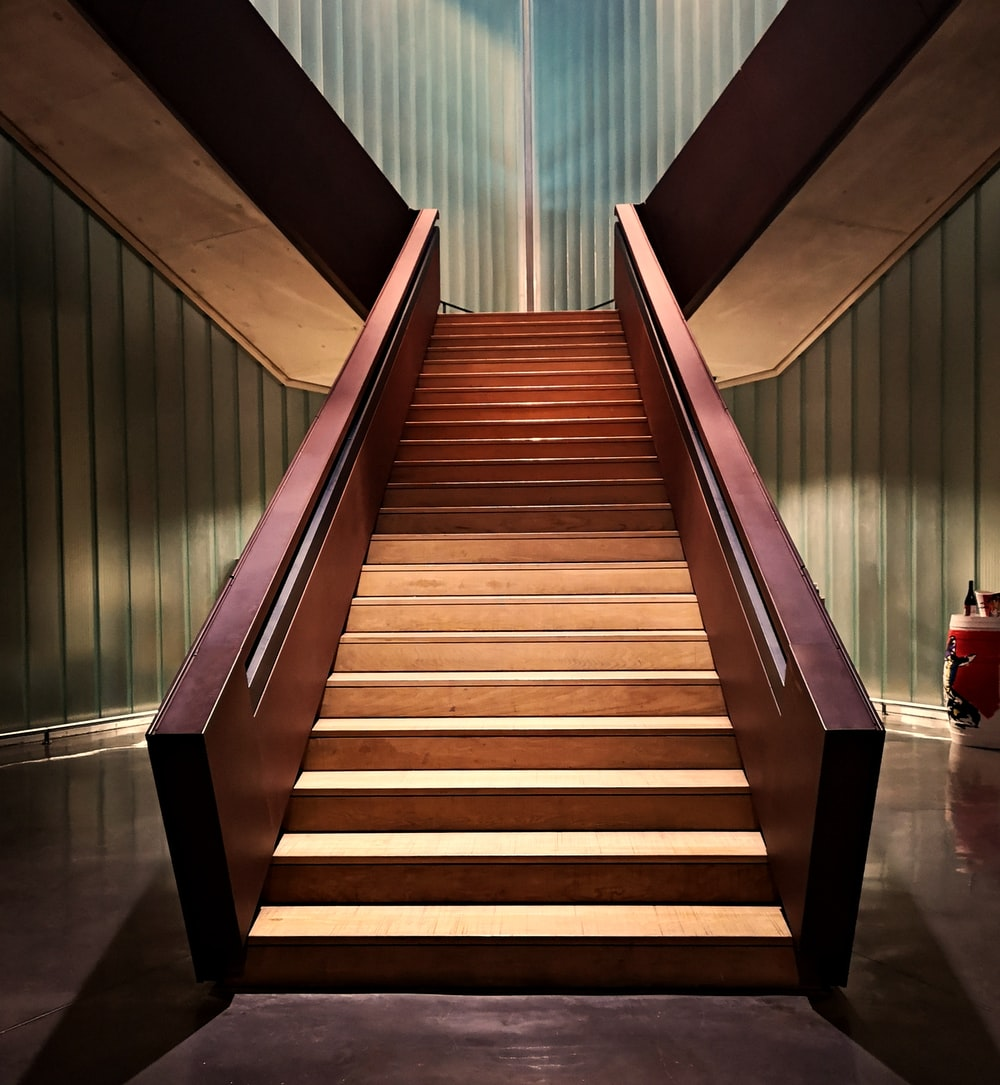 brown stair on focus photography