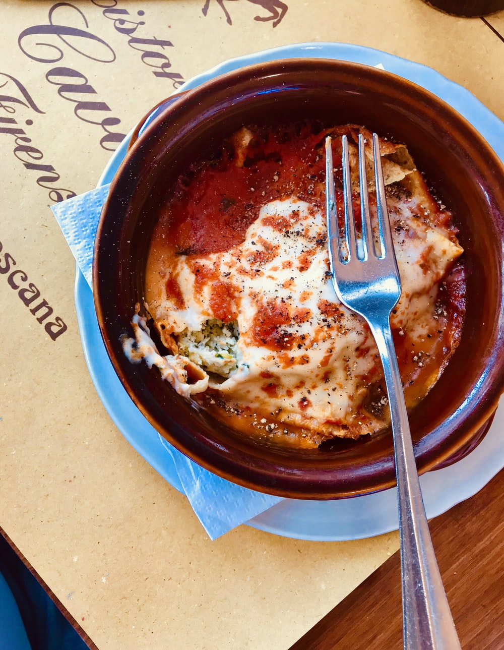 lasagna on maroon bowl