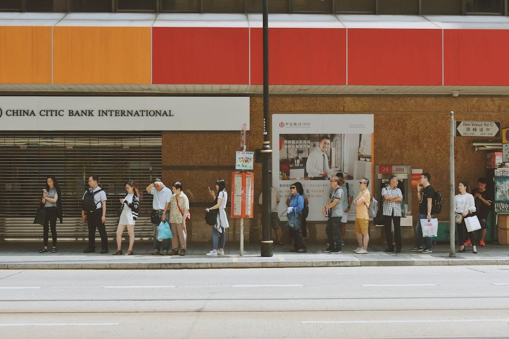 people fall inline on sidewalk