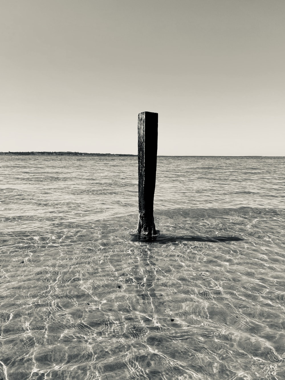 grayscale photography of wooden stand