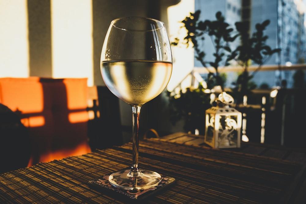 half-filled long-stem wine glass