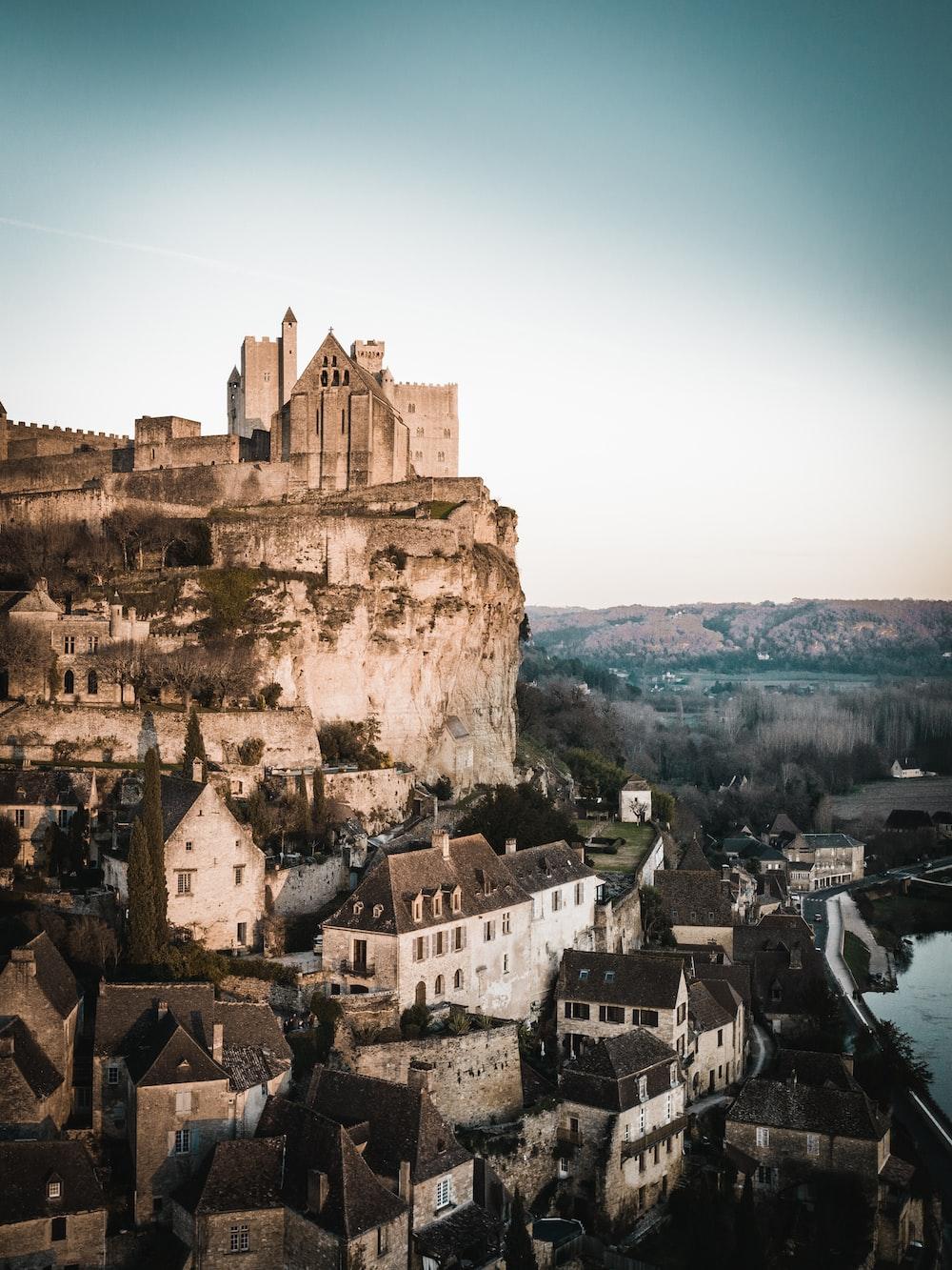 grey castle on rock mountain