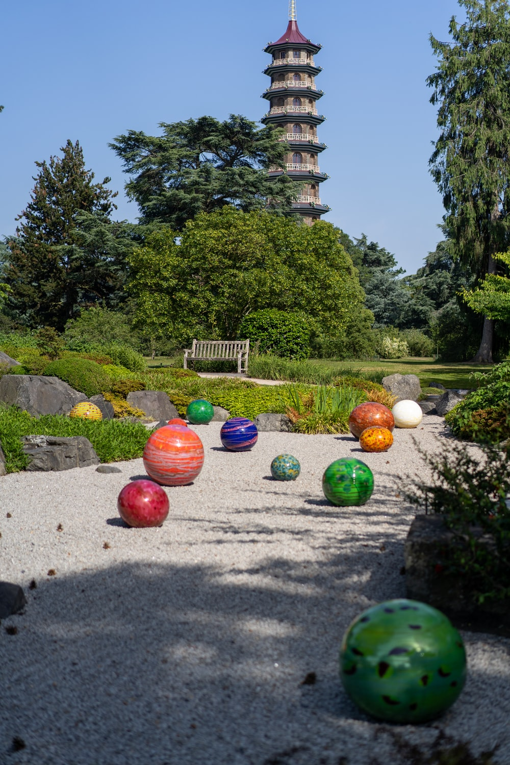 assorted-color balls near trees during daytime