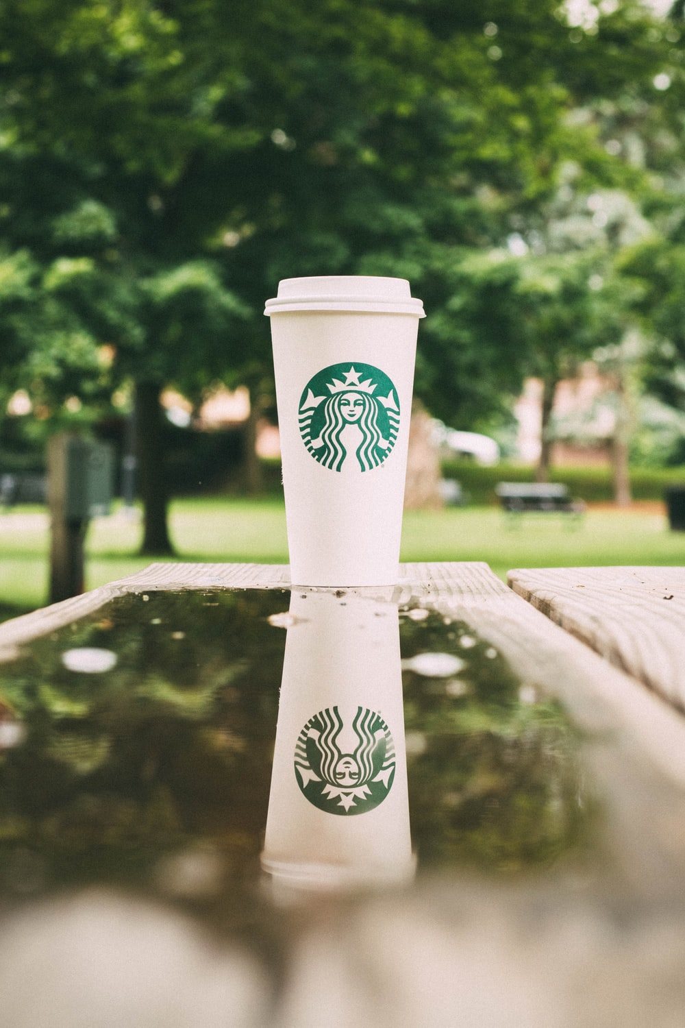 white Starbucks coffee cup on table