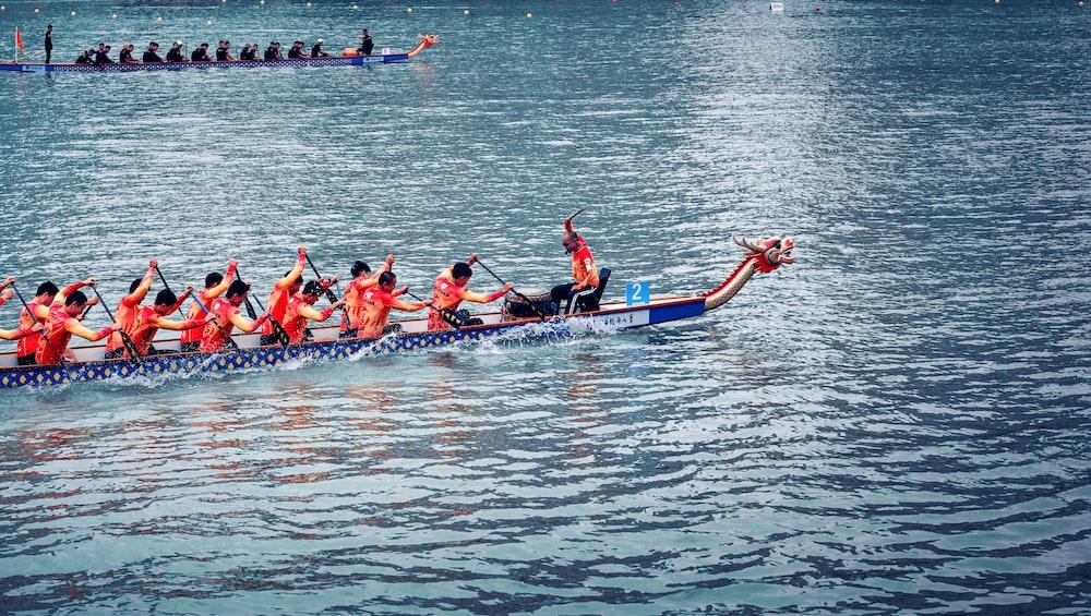 men on boat rowing