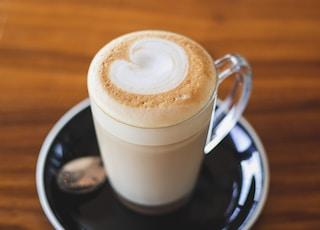 clear glass mug with latte art