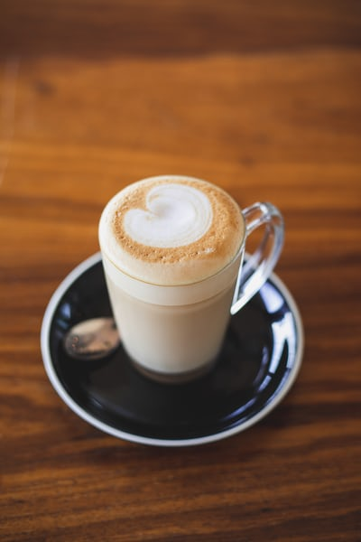clear glass mug with latte art