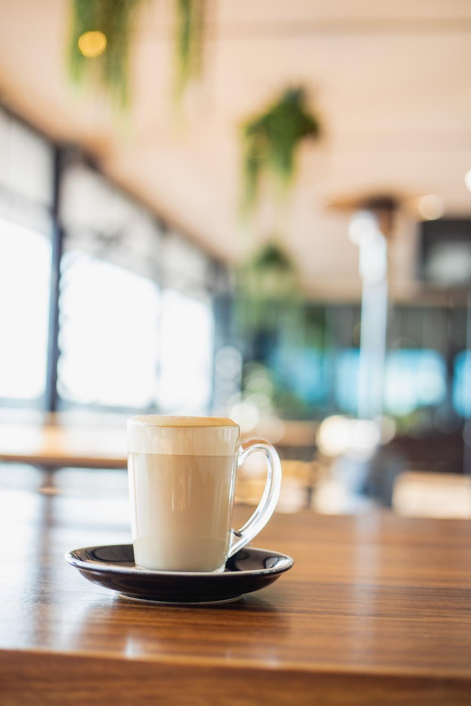brown liquid inside clear glass mug