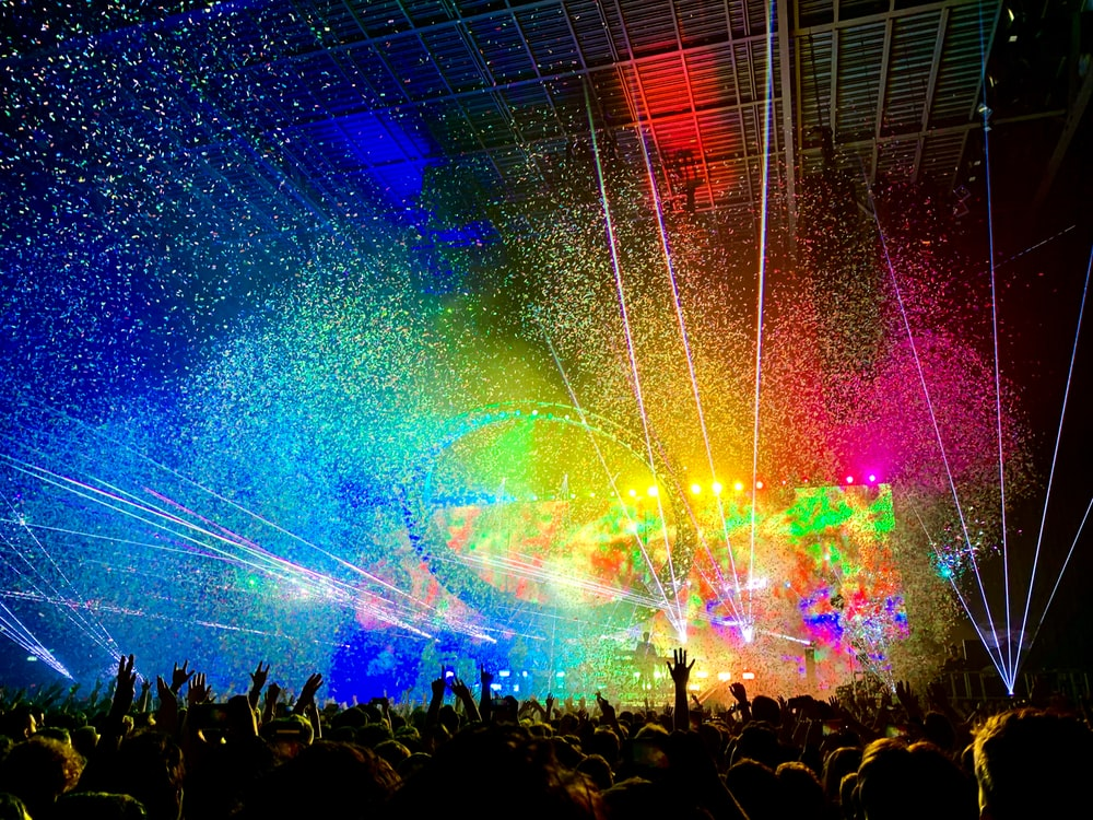 people watching concert with multicolored stage light display