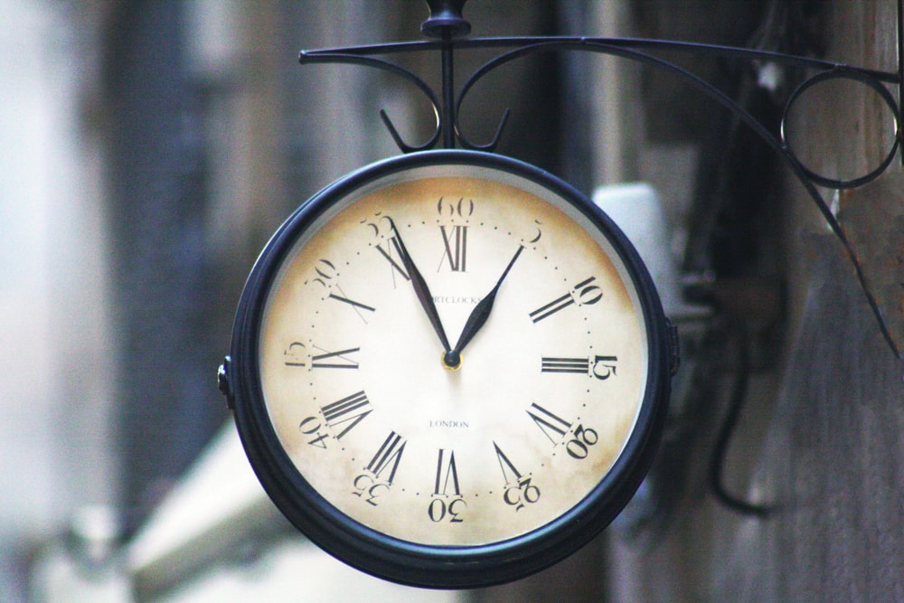 round black framed analog clock