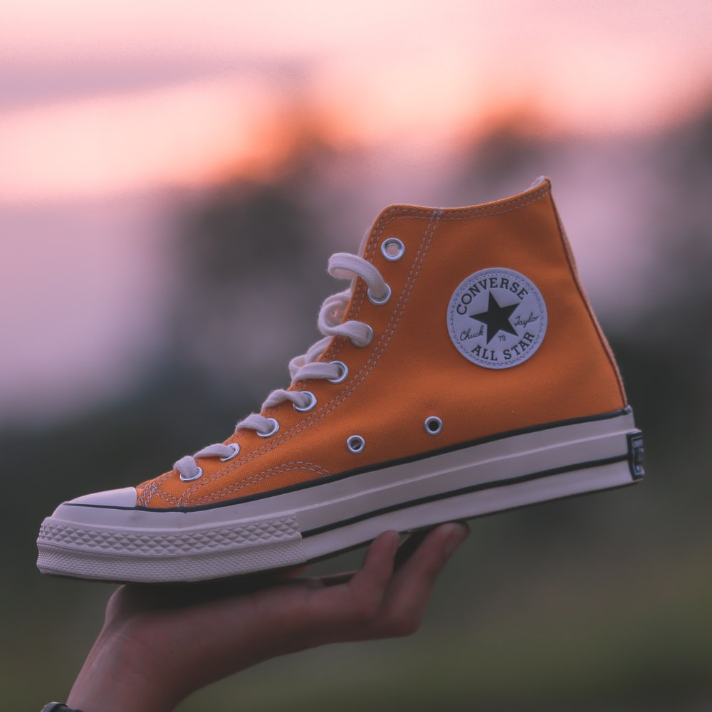 unpaired orange and white Converse All-Star high-top