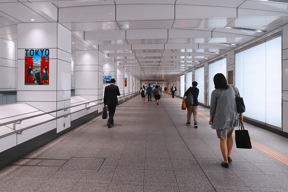 people walking on walkway inside building during daytime