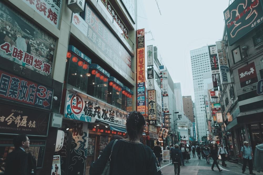 people walking on road near buildings